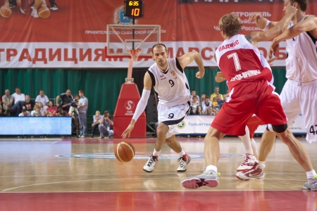 bc krasnye krylia samara: SAMARA, RUSSIA - MAY 12: Rolandas Alijevas of BC Krasnye Krylia, with ball, is on the attack during a BC Spartak-Primorje game on May 12, 2012 in Samara, Russia.