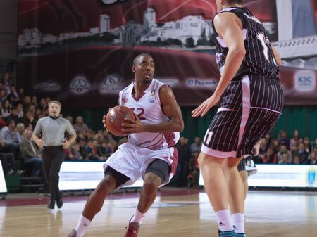 pbl: SAMARA, RUSSIA - OCTOBER 19: Aaron Marquez Miles of BC Krasnye Krylia, with ball, is on the attack during a BC Nizhniy Novgorod game on October 19, 2012 in Samara, Russia.