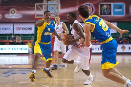 vasiliev: SAMARA, RUSSIA - OCTOBER 22: Omar Thomas of BC Krasnye Krylia with ball tries to go past a BC Astana player on October 22, 2012 in Samara, Russia. Editorial
