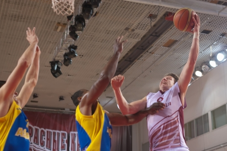 bc krasnye krylia samara: SAMARA, RUSSIA - OCTOBER 22: Dmitriy Kulagin of BC Krasnye Krylia with ball attacks a basket during a BC Astana game on October 22, 2012 in Samara, Russia.
