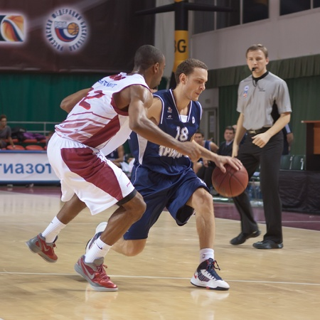 pbl: SAMARA, RUSSIA - NOVEMBER 03: Yuval Naimy of BC Triumph with ball tries to go past a BC Krasnye Krylia player on November 03, 2012 in Samara, Russia. Editorial