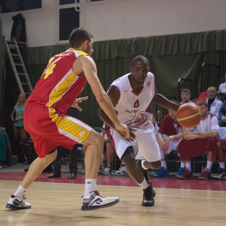 alexandros: SAMARA, RUSSIA - NOVEMBER 07: Omar Thomas of BC Krasnye Krylia with ball tries to go past a BC KERAVNOS STROVOLOU player on November 07, 2012 in Samara, Russia.