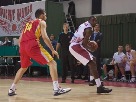 alexandros: SAMARA, RUSSIA - NOVEMBER 07: Omar Thomas of BC Krasnye Krylia, with ball, is on the attack during a BC KERAVNOS STROVOLOU game on November 07, 2012 in Samara, Russia. Editorial
