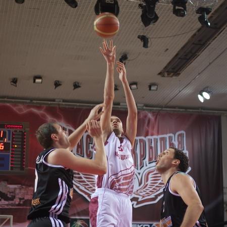 SAMARA, RUSSIA - NOVEMBER 10: Nikita Balashov of BC Krasnye Krylia throws a ball in a basket during a BC Donetsk game on November 10, 2012 in Samara, Russia.