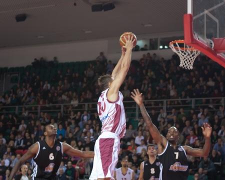 vasiliev: SAMARA, RUSSIA - NOVEMBER 10: Yury Vasiliev of BC Krasnye Krylia with ball attacks a basket during a BC Donetsk game on November 10, 2012 in Samara, Russia.