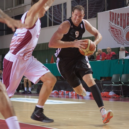vasiliev: SAMARA, RUSSIA - NOVEMBER 10: Darius Songaila of BC Donetsk with ball tries to go past a BC Krasnye Krylia player on November 10, 2012 in Samara, Russia. Editorial