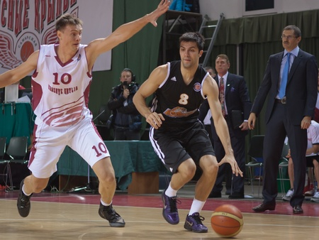vasiliev: SAMARA, RUSSIA - NOVEMBER 10: Vojdan Stojanovski of BC Donetsk with ball tries to go past a BC Krasnye Krylia player on November 10, 2012 in Samara, Russia. Editorial