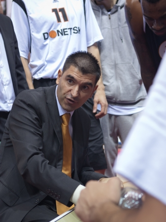 josep: SAMARA, RUSSIA - NOVEMBER 10: Time out. Coach of BC Donetsk Josep Riera says the game plan against BC Krasnye Krylia player on November 10, 2012 in Samara, Russia.