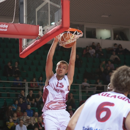 number 15: SAMARA, RUSSIA - DECEMBER 05: Nikita Balashov of BC Krasnye Krylia makes slam dunk in the game against BC CSU Asesoft Ploiesti on December 05, 2012 in Samara, Russia.