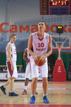 vasiliev: SAMARA, RUSSIA - DECEMBER 05: Yury Vasiliev of BC Krasnye Krylia gets ready to throw from the free throw line in a game against BC CSU Asesoft Ploiesti on December 05, 2012 in Samara, Russia.