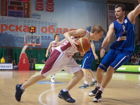 SAMARA, RUSSIA - DECEMBER 05: Evgeny Kolesnikov of BC Krasnye Krylia with ball goes against a BC CSU Asesoft Ploiesti player on December 05, 2012 in Samara, Russia. Editorial