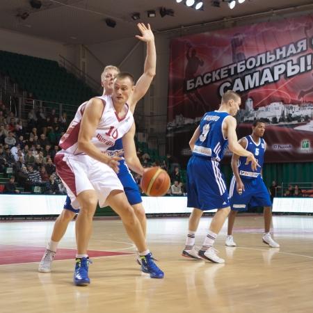 vasiliev: SAMARA, RUSSIA - DECEMBER 11: Yury Vasiliev of BC Krasnye Krylia, with ball, is on the attack during a BC Joensuun Kataja game on December 11, 2012 in Samara, Russia.