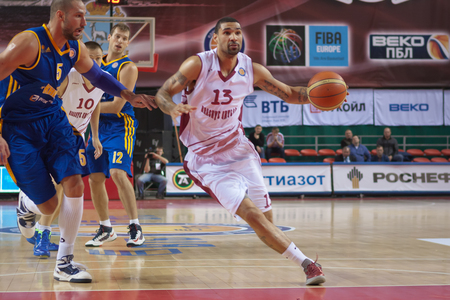 vasiliev: SAMARA, RUSSIA - DECEMBER 17: Chester Simmons of BC Krasnye Krylia, with ball, is on the attack during a BC Khimki game on December 17, 2012 in Samara, Russia.