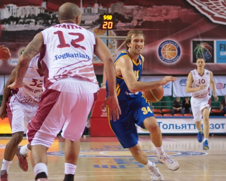 vasiliev: SAMARA, RUSSIA - DECEMBER 17: Zoran Planinic of BC Khimki, with ball, is on the attack during a BC Krasnye Krylia game on December 17, 2012 in Samara, Russia.