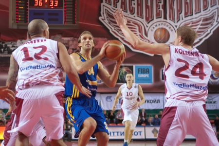 vasiliev: SAMARA, RUSSIA - DECEMBER 17: Zoran Planinic of BC Khimki with ball goes against a BC Krasnye Krylia player on December 17, 2012 in Samara, Russia.