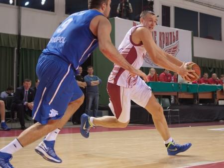 vasiliev: SAMARA, RUSSIA - JANUARY 07: Yury Vasiliev of BC Krasnye Krylia with ball tries to go past a BC Azovmash player on January 07, 2013 in Samara, Russia.