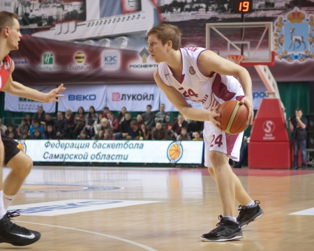 SAMARA, RUSSIA - JANUARY 12: Evgeny Kolesnikov of BC Krasnye Krylia with ball goes against a BC Lietuvos Rytas player on January 12, 2013 in Samara, Russia.