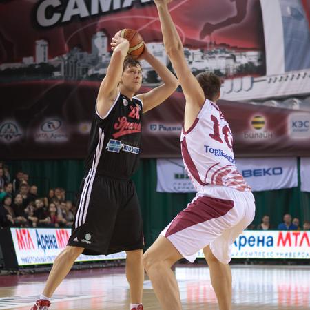 bc krasnye krylia samara: SAMARA, RUSSIA - FEBRUARY 15: Fedor Dmitriev of BC Spartak, with ball, is on the attack during a BC Krasnye Krylia game on February 15, 2013 in Samara, Russia.