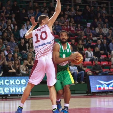 vasiliev: SAMARA, RUSSIA - FEBRUARY 19: Willie Deane of BC Khimik with ball tries to go past a BC Krasnye Krylia player on February 19, 2013 in Samara, Russia.