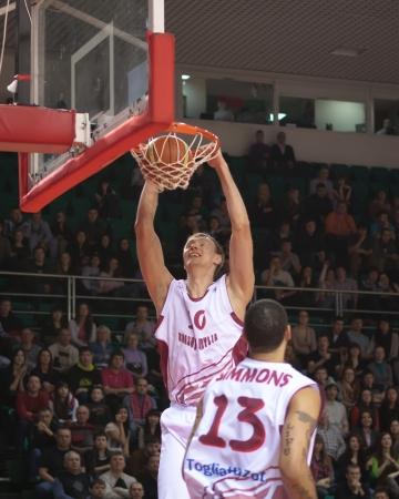 vasiliev: SAMARA, RUSSIA - FEBRUARY 26: Yury Vasiliev of BC Krasnye Krylia makes slam dunk in a BC TOFAS SC BURSA game on February 26, 2013 in Samara, Russia.