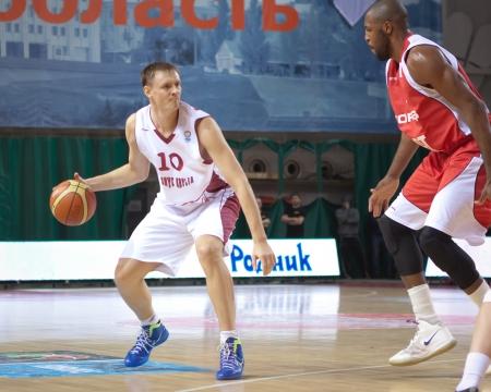 vasiliev: SAMARA, RUSSIA - FEBRUARY 26: Yury Vasiliev of BC Krasnye Krylia with ball goes against a BC TOFAS SC BURSA player on February 26, 2013 in Samara, Russia. Editorial