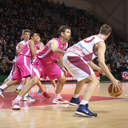 vasiliev: SAMARA, RUSSIA - MARCH 12: Yury Vasiliev of BC Krasnye Krylia with ball tries to go past a BC Telekom Baskets Bonn player on March 12, 2013 in Samara, Russia.