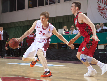 pbl: SAMARA, RUSSIA - APRIL 06: Evgeny Kolesnikov of BC Krasnye Krylia, with ball, is on the attack during a BC Lokomotiv-Kuban game on April 06, 2013 in Samara, Russia.