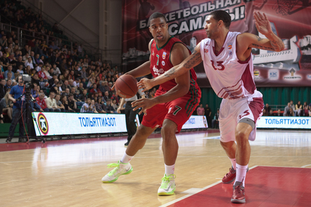 pbl: SAMARA, RUSSIA - APRIL 06: Richard Hendrix of BC Lokomotiv-Kuban with ball tries to go past a BC Krasnye Krylia player on April 06, 2013 in Samara, Russia.