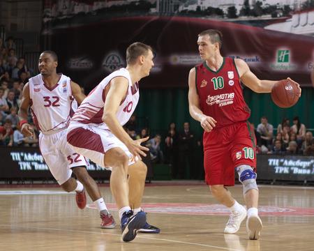 vasiliev: SAMARA, RUSSIA - APRIL 06: Sergey Bykov of BC Lokomotiv-Kuban with ball goes against a BC Krasnye Krylia player on April 06, 2013 in Samara, Russia.