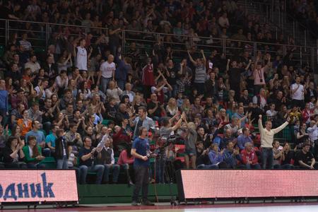 international basketball: SAMARA, RUSSIA - APRIL 06: Fans and spectators enjoyed on tribunes at the game between BC Krasnye Krylia and BC Lokomotiv-Kuban on April 06, 2013 in Samara, Russia. Editorial
