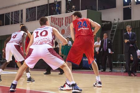 vasiliev: SAMARA, RUSSIA - APRIL 21: Alexander Kaun of BC CSKA, with ball, is on the attack during a BC Krasnye Krylia game on April 21, 2013 in Samara, Russia.