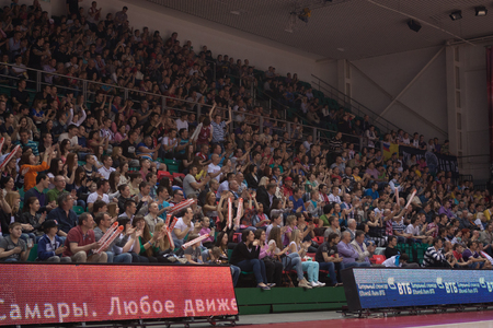 international basketball: SAMARA, RUSSIA - MAY 03: Fans and spectators enjoyed on tribunes at the game between BC Krasnye Krylia and BC Triumph on May 03, 2013 in Samara, Russia. Editorial