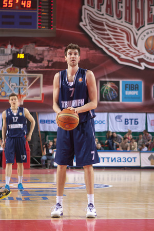 mikhail: SAMARA, RUSSIA - MAY 03: Sergey Karasev of BC Triumph gets ready to throw from the free throw line in a game against BC Krasnye Krylia on May 03, 2013 in Samara, Russia.