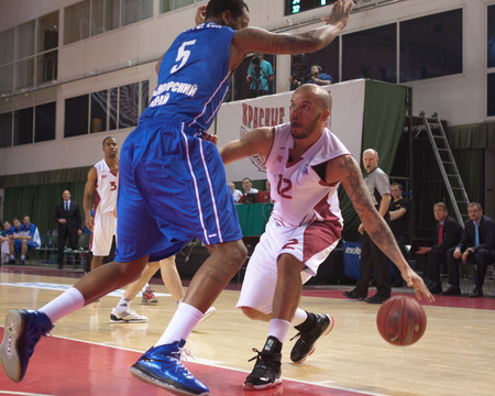 pbl: SAMARA, RUSSIA - MAY 11: Andre Smith of BC Krasnye Krylia with ball tries to go past a BC Enisey player on May 11, 2013 in Samara, Russia.