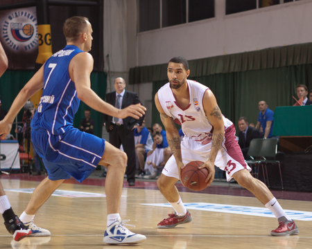 pbl: SAMARA, RUSSIA - MAY 11: Chester Simmons of BC Krasnye Krylia with ball goes against a BC Enisey player on May 11, 2013 in Samara, Russia. Editorial