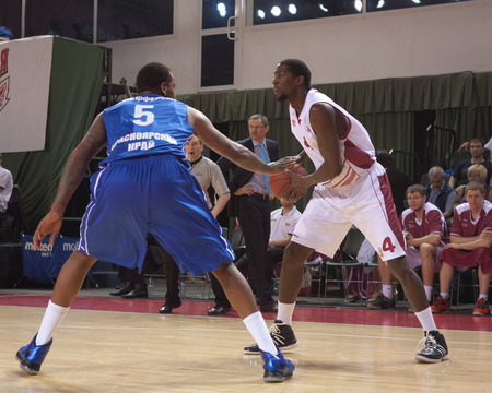 pbl: SAMARA, RUSSIA - MAY 11: Omar Thomas of BC Krasnye Krylia, with ball, is on the attack during a BC Enisey game on May 11, 2013 in Samara, Russia. Editorial