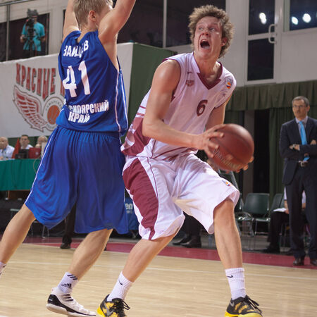pbl: SAMARA, RUSSIA - MAY 11: Dmitry Kulagin of BC Krasnye Krylia, with ball, is on the attack during a BC Enisey game on May 11, 2013 in Samara, Russia.