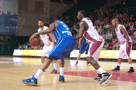 pbl: SAMARA, RUSSIA - MAY 11: Jerry Jefferson of BC Enisey with ball tries to go past a BC Krasnye Krylia player on May 11, 2013 in Samara, Russia. Editorial