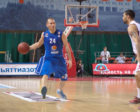 pbl: SAMARA, RUSSIA - MAY 11: Andrey Kuzemkin of BC Enisey, with ball, is on the attack during a BC Krasnye Krylia game on May 11, 2013 in Samara, Russia.