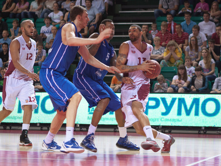 pbl: SAMARA, RUSSIA - MAY 11: Chester Simmons of BC Krasnye Krylia with ball tries to go past a BC Enisey player on May 11, 2013 in Samara, Russia.