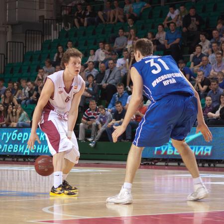 pbl: SAMARA, RUSSIA - MAY 11: Dmitriy Kulagin of BC Krasnye Krylia with ball goes against a BC Enisey player on May 11, 2013 in Samara, Russia.