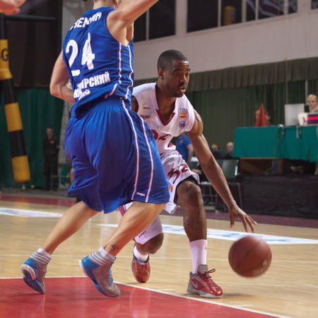 pbl: SAMARA, RUSSIA - MAY 11: Aaron Miles of BC Krasnye Krylia with ball tries to go past a BC Enisey player on May 11, 2013 in Samara, Russia.