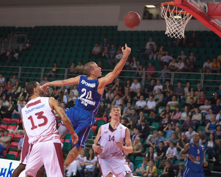 pbl: SAMARA, RUSSIA - MAY 11: Andrey Kuzemkin of BC Enisey throws the ball in a basket during a BC Krasnye Krylia game on May 11, 2013 in Samara, Russia.