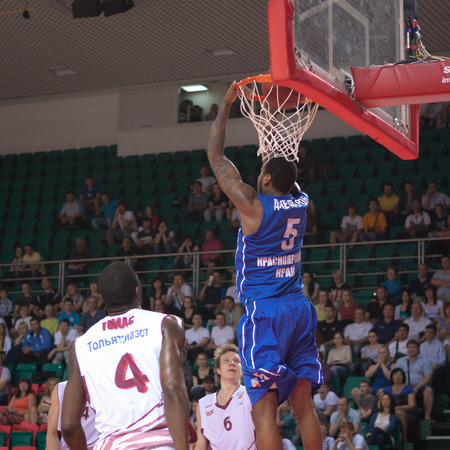 dunk: SAMARA, RUSSIA - MAY 11: Jerry Jefferson of BC Enisey makes slam dunk in a BC Krasnye Krylia game on May 11, 2013 in Samara, Russia. Editorial
