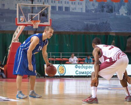 pbl: SAMARA, RUSSIA - MAY 11: Andrey Kuzemkin of BC Enisey with ball goes against a BC Krasnye Krylia player on May 11, 2013 in Samara, Russia.