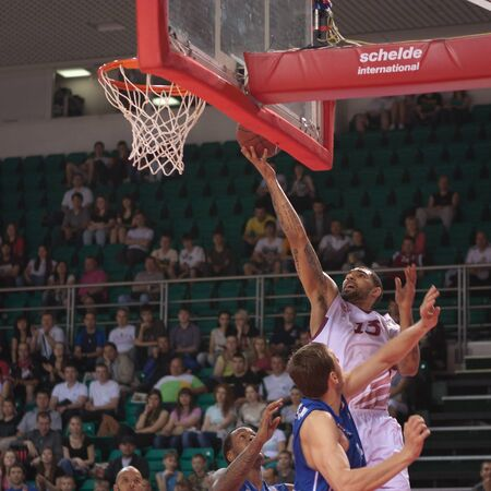 pbl: SAMARA, RUSSIA - MAY 11: Chester Simmons of BC Krasnye Krylia throws the ball in a basket during a BC Enisey game on May 11, 2013 in Samara, Russia. Editorial