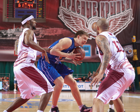 teammate: SAMARA, RUSSIA - MAY 11: Petr Gubanov of BC Enisey, with ball, is on the attack during a BC Krasnye Krylia game on May 11, 2013 in Samara, Russia. Editorial