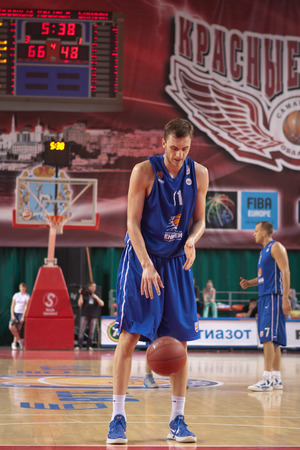 teammate: SAMARA, RUSSIA - MAY 11: Elmedin Kikanovic of BC Enisey gets ready to throw from the free throw line in a game against BC Krasnye Krylia on May 11, 2013 in Samara, Russia.
