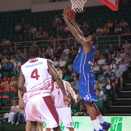 pbl: SAMARA, RUSSIA - MAY 11: Jerry Jefferson of BC Enisey, with ball, is on the attack during a BC Krasnye Krylia game on May 11, 2013 in Samara, Russia.