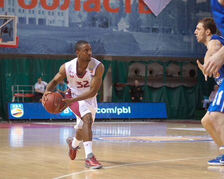 pbl: SAMARA, RUSSIA - MAY 11: Aaron Miles of BC Krasnye Krylia, with ball, is on the attack during a BC Enisey game on May 11, 2013 in Samara, Russia. Editorial